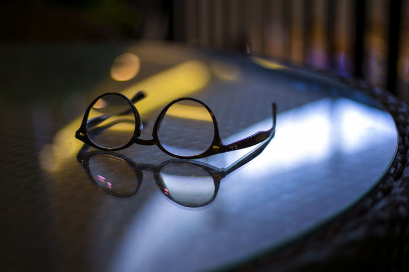 Absence Circle Close-up Day Eyeglasses  Focus On Foreground Glass - Material Glasses High Angle View Indoors  No People Personal Accessory Reflection Selective Focus Shadow Still Life Table Transparent Vision