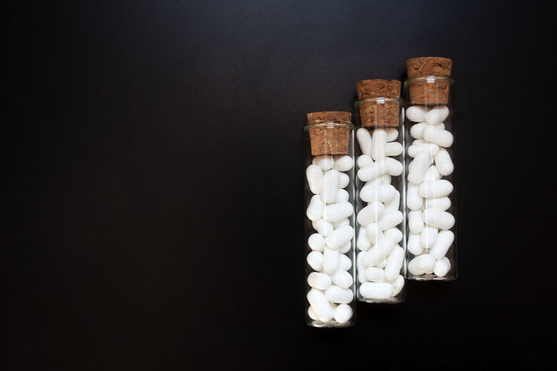 High angle view of bottles in container over black background