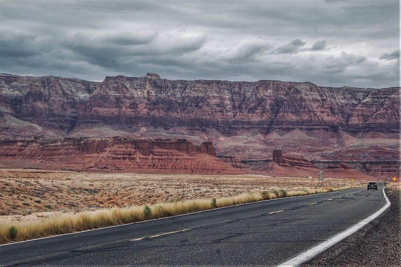 Route 66 EyeEm Selects EyeEmNewHere Cloud - Sky Sky Road Landscape Scenics - Nature Environment Beauty In Nature Non-urban Scene Transportation Remote Mountain Travel Rock - Object Nature Tranquil Scene No People Outdoors Day Tranquility Land