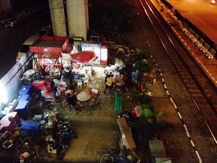 Take away shop By Railway Soft Drink Under The Bridge Bangkok Thailand Night Time