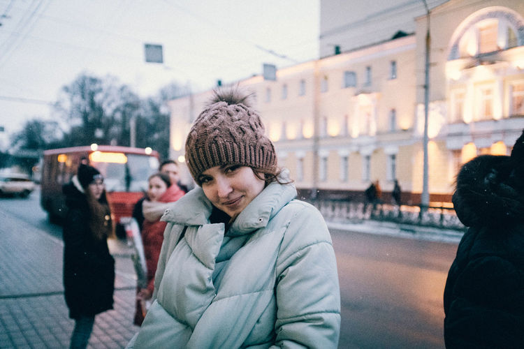Portrait of people in city street during winter