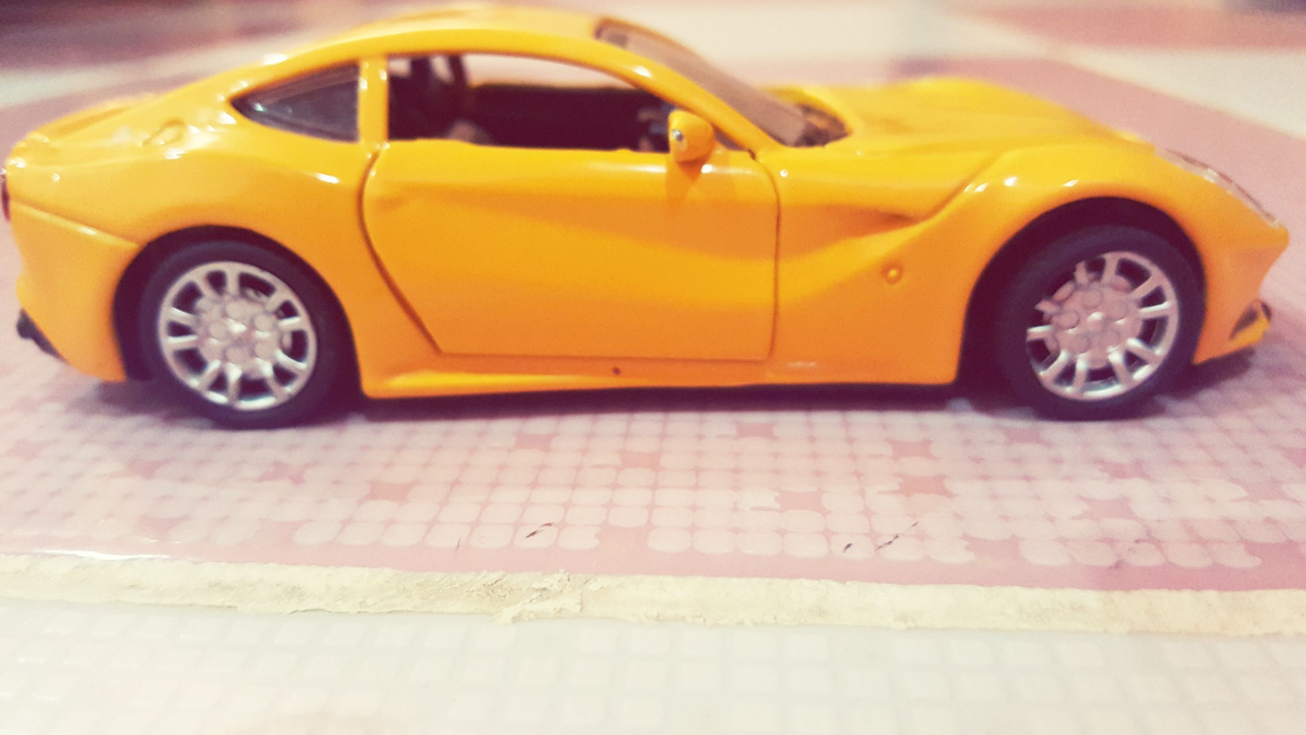 car, transportation, yellow, land vehicle, street, taxi, mode of transport, wheel, collector's car, stationary, outdoors, toy car, day, no people, yellow taxi, tire