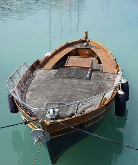 High angle view of fishing boat moored on lake