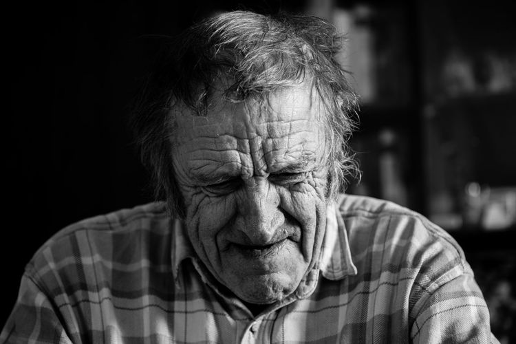 Happiness EyeEmNewHere Adult Black Background Close-up Contemplation Depression - Sadness Despair Emotion Front View Headshot Hopelessness Human Face Indoors  Lifestyles Males  Mature Men Men One Person Portrait Real People Sadness Senior Adult Senior Men Wrinkled