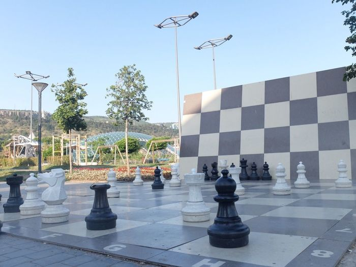 Full frame shot of chess board on street against sky