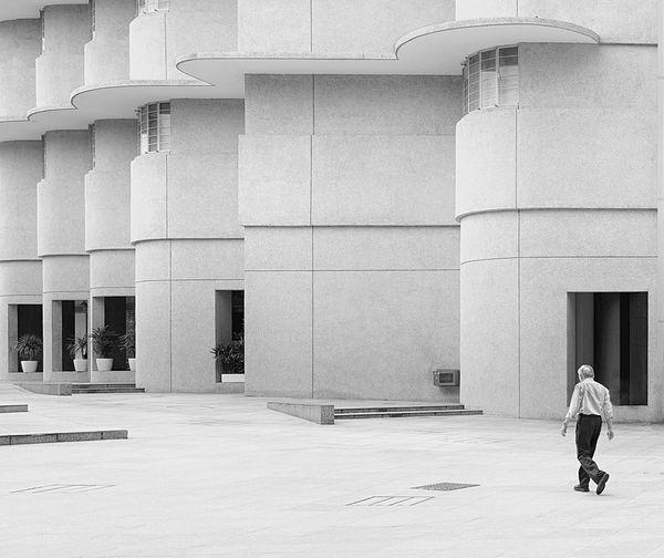 Rear view of a woman walking in city