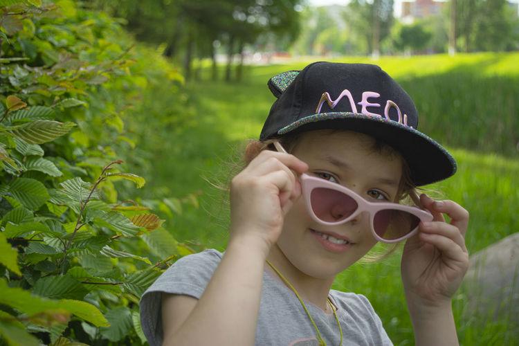 Portrait of boy wearing sunglasses against plants
