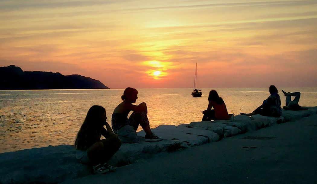 Beach Sea Sunset People Awe Tranquility Sitting Adults Only Outdoors Beauty In Nature At The Sunset Adult Day Sunset Nature Horizon Over Water Tranquility Waiting For Sunset Beautiful Sunset Sunset Silhouettes Sunset_collection