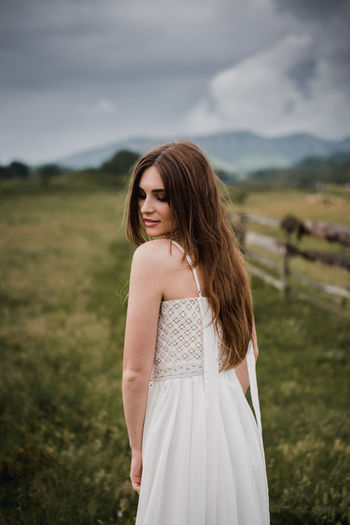 Wedding photography. Young bride in a beautiful white dress posing near a wooden fence. Wedding in the style of the countryside. Photo taken in nature with daylight. Picturesque landscape. In the background a field with green grass, sky with clouds and mountains. Wedding Wedding Photography Beautiful Woman Beauty Brown Hair Dress Fashion Field Focus On Foreground Hair Hairstyle Land Long Hair One Person Outdoors Portrait Smiling Standing Teenager Three Quarter Length Wedding Day Wedding Dress Women Young Adult Young Women The Portraitist - 2018 EyeEm Awards The Still Life Photographer - 2018 EyeEm Awards The Fashion Photographer - 2018 EyeEm Awards 10 The Photojournalist - 2018 EyeEm Awards The Great Outdoors - 2018 EyeEm Awards The Creative - 2018 EyeEm Awards The Street Photographer - 2018 EyeEm Awards Love Is Love