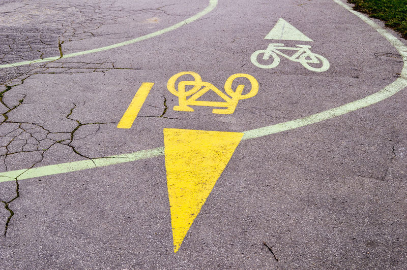 Direction Directional Sign Bicycle Lane Bicycle Path Railing Road Transportation Cycling Around Information Sign Road Sign Road Lifestyles City Outdoors Minimal Street Streetphotography