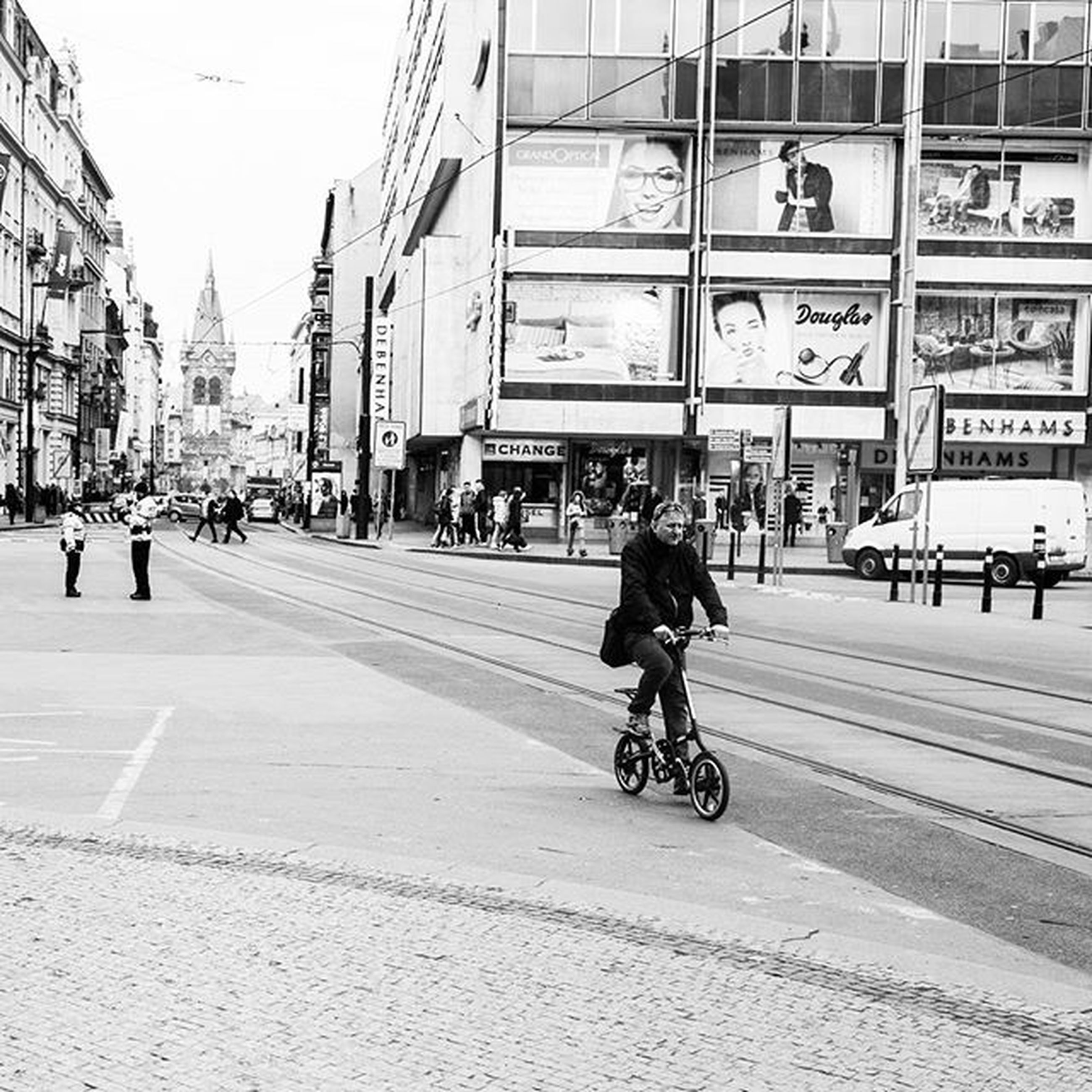 transportation, city, architecture, street, men, built structure, building exterior, city life, walking, person, land vehicle, mode of transport, lifestyles, bicycle, large group of people, city street, road, full length, leisure activity