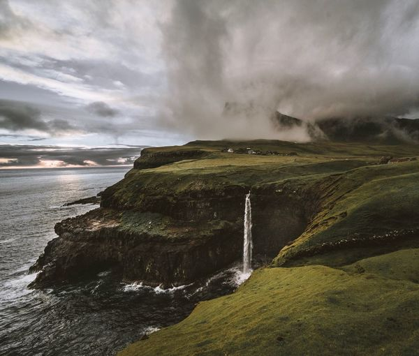 Gasadalur Faroe Islands Gasadalur Cloud - Sky Water Sky Nature Land Beauty In Nature Scenics - Nature Outdoors Sea Environment Tranquil Scene Motion Non-urban Scene Power In Nature Beach No People Rock Tranquility Day