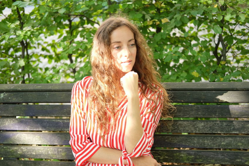 Summer in the park Beautiful Woman Bench Brown Hair Contemplation Day Front View Hair Hairstyle Leisure Activity Lifestyles Long Hair One Person Outdoors Park Bench Plant Portrait Seat Sitting Smiling Teenager Waist Up Wood - Material Young Adult