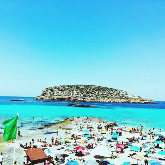 Eivissa Sea Beach Sand Blue Water Horizon Over Water Vacations Relaxation Clear Sky Tourism Large Group Of People Nature Travel Destinations Scenics Sky Tranquil Scene Summer Outdoors Beauty In Nature Beach Umbrella