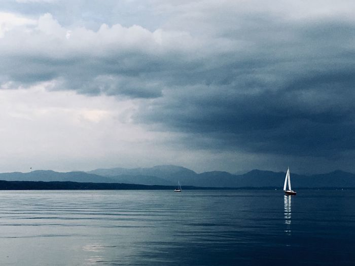 Last Summer Day Lake of Starnberg Calm Water Mystical Atmosphere Tranquil Scene Stormy Weather Cloud - Sky Sky Water Nautical Vessel Beauty In Nature Mountain Mode Of Transportation Cloud - Sky Sky Water Nautical Vessel Beauty In Nature Mountain Mode Of Transportation