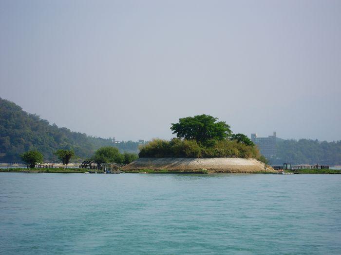 The small Lalu Island in Sun Moon Lake,Taiwan Water Tree Lake Nature Palm Tree Scenics Tranquil Scene No People Outdoors Day Beauty In Nature Sky Lalu Island Taiwan