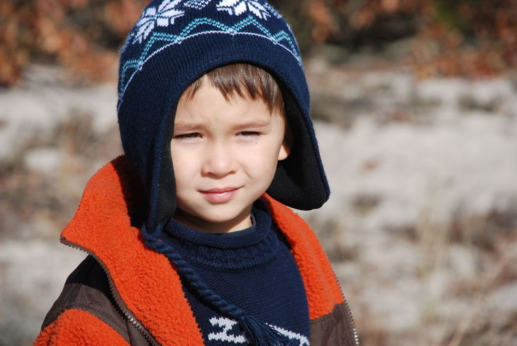 Young boy on a nature walk in the winter. Nature Beach Boy Childhood Cold Temperature Half Asian Headshot Knit Hat Nature Walk Outdoors Real People Warm Clothing Winter