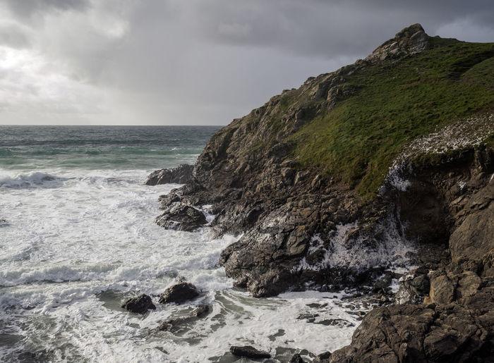 Costline at the lizard cornwall. Sea foam being blown onto the cliff. Beauty In Nature Coast Coastline Horizon Over Water Nature Scenics Sea Water