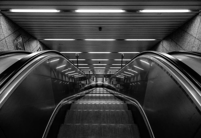 the escalator ... B&w Photography Ceiling Design Downwards Escalator Full Frame Indoors  Metal Metallic Nach Unten Pattern Railing Railroad Station Repetition Rolltreppe Shiny Staircase Steps Steps And Staircases Technology Transportation Urban Wall