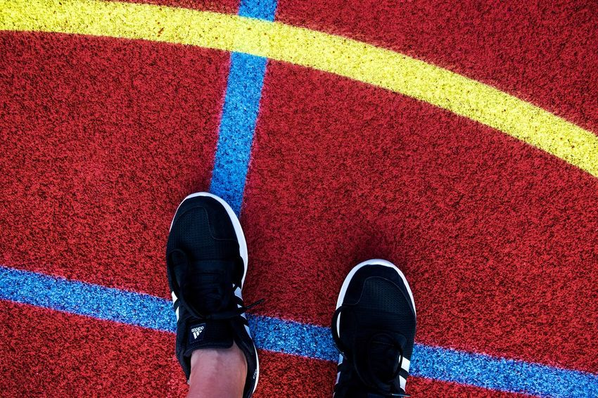 Urban Perspectives The Devil's In The Detail Low Section Sport Running Track Sports Track Red Human Leg Shoe Marking High Angle View Standing Human Foot Footwear Dividing Line Personal Perspective Feet Canvas Shoe Yellow Line