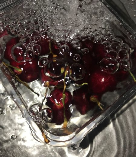 High angle view of berries in glass bowl