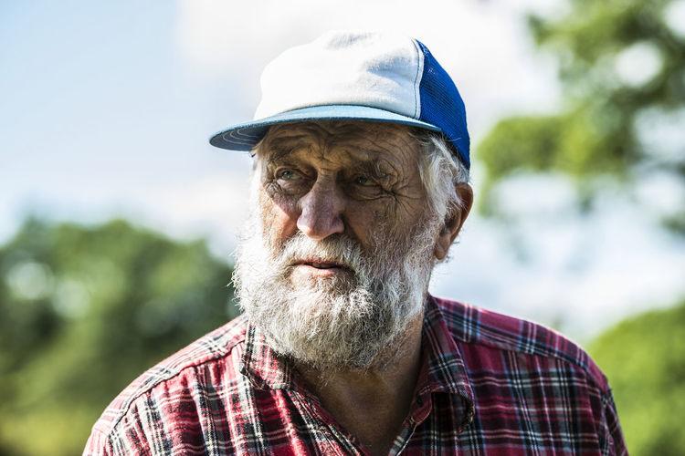 Portrait of man wearing hat outdoors