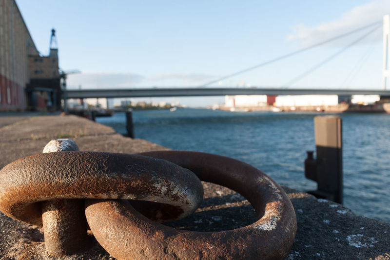 Close-up of rusty metal on promenade in city