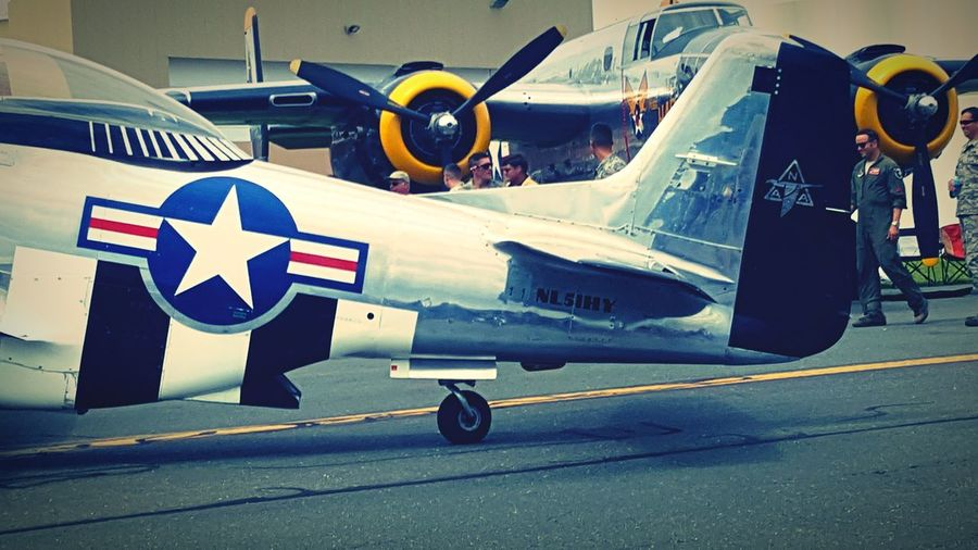 Air Vehicle Airport No People Airshow Day Outdoors Fighter Plane Mustang P51 Mustang P51 Transportation Mode Of Transport Airplane Business Finance And Industry Transportation Flag Technology Innovation Aerospace Industry Industry Politics And Government Close-up