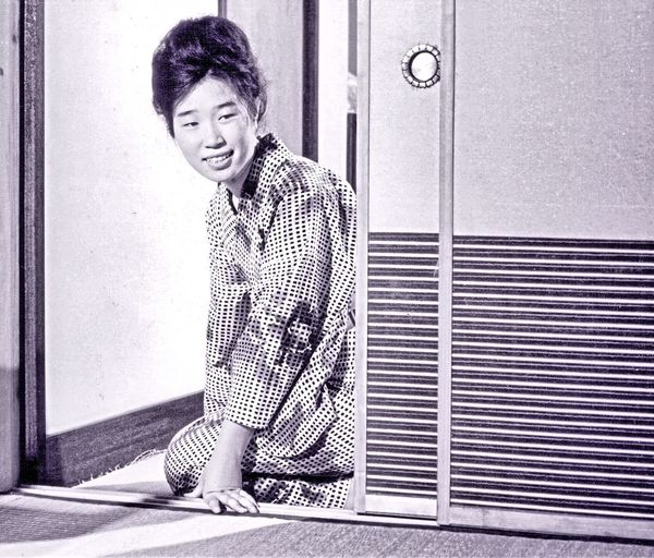 Japan Young Japanese Housewife sliding door Family Life Japanese housewife greeting husband Indoors  at home Smiling Yoko Black And White Photography