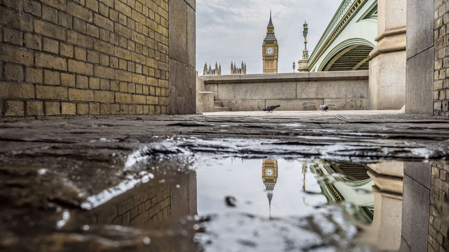 Reflection of big ben in puddle