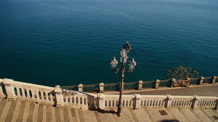 High Angle View Of Lamp Post On Promenade By Sea