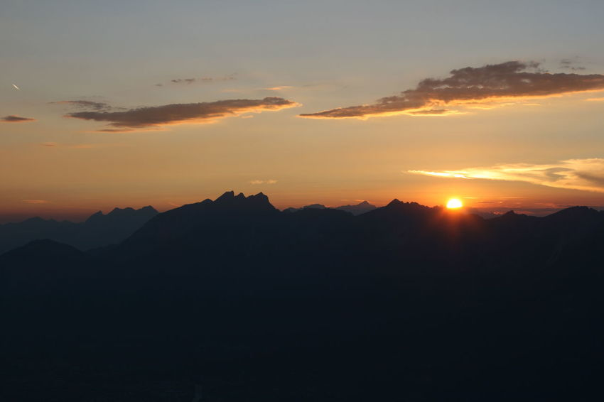 Sunset over the mountains of Innsbruck Berge Tirol  Beauty In Nature Idyllic Landscape Lovetirol Mountain Mountain Peak Mountain Range Mountainrange Nature Neverstopexploring  No People Orange Color Perfectday Silhouette Sky Sun Sunlight Sunset