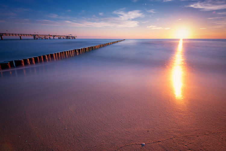 Sunrise on Koserow beach Sky Sunset Water Scenics - Nature Beauty In Nature Sea Tranquil Scene Tranquility Reflection Beach Horizon Over Water Idyllic Cloud - Sky Horizon Nature Land Non-urban Scene Pier Orange Color Sun Sea Bridge Baltic Sea Morning Light Sunrise Usedom