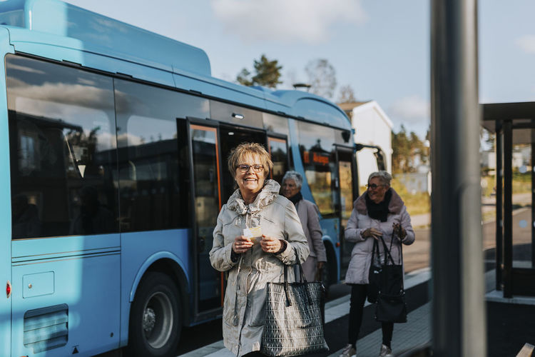 Portrait of smiling man and woman on bus