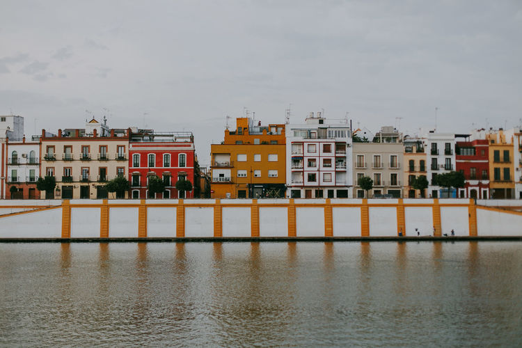 Architecture Built Structure Building Exterior Waterfront Building Residential District Reflection Outdoors River Apartment Colorful House SPAIN Sevilla Travel Travel Destinations