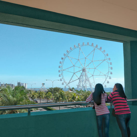 Ferris Wheel as seen from the SM Mall of Asia Mobilephotography Mobile Photography EyeEm Best Shots Street Photography Streetphotography Philippines Amusement Park Ferris Wheel Eyeem Philippines City Togetherness Bonding Women Rear View Sky Amusement Park Ride The Mobile Photographer - 2019 EyeEm Awards The Street Photographer - 2019 EyeEm Awards My Best Photo