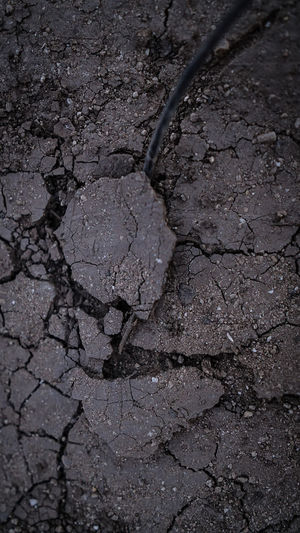 High angle view of cracked road