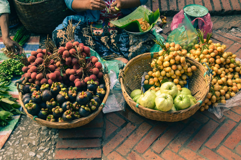 High angle view of exotic fruits for sale in luang prabang morning market