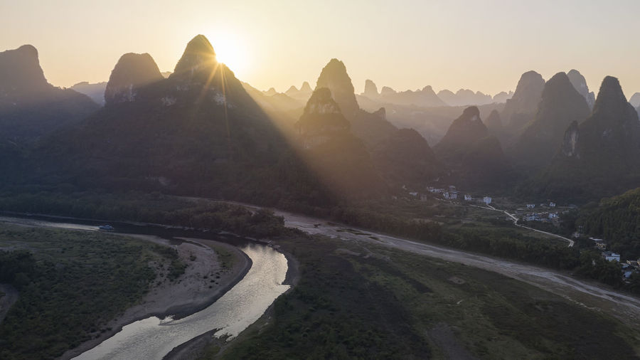 Aerial view of mountains during sunrise