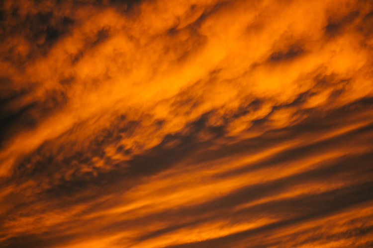 Sky Sunset Orange Color Cloud - Sky Beauty In Nature Scenics - Nature Dramatic Sky Backgrounds No People Tranquility Nature Full Frame Tranquil Scene Idyllic Cloudscape Low Angle View Outdoors Awe Majestic Abstract Meteorology