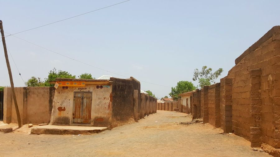 View of small hut in village against clear sky