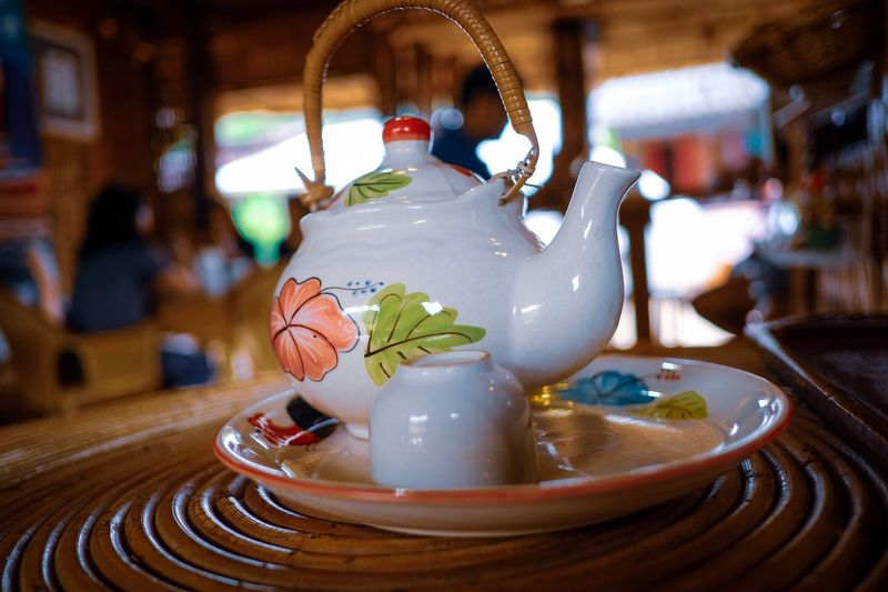Tea pot EyeEm Tea Teapot Focus On Foreground Art And Craft Ceramics Food And Drink Indoors  Table Close-up Restaurant Drink Teapot Tea Cup Still Life Refreshment Craft Creativity Business Representation Animal Representation No People Crockery