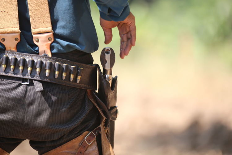 Midsection Focus On Foreground One Person Standing Weapon Men Real People Clothing Day Protection Outdoors Nature Safety Security Gun Belt  Land Rear View Human Body Part Government Uniform