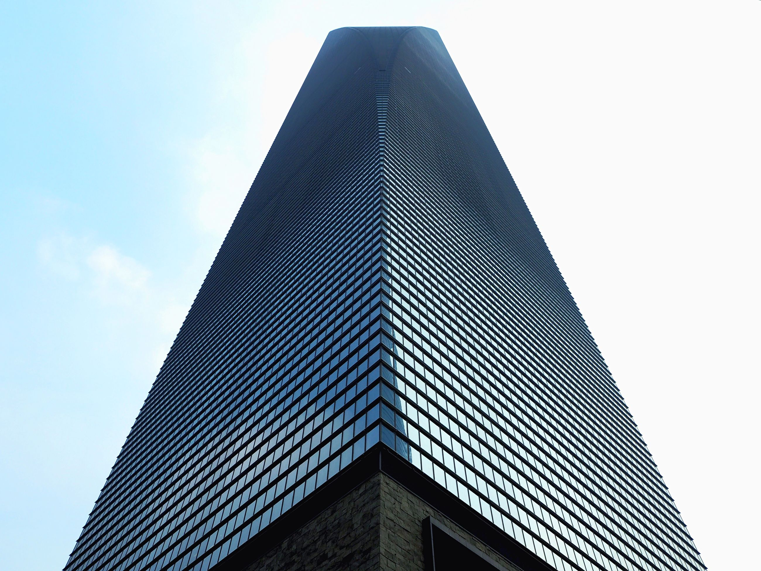 architecture, low angle view, building exterior, built structure, tall - high, tower, clear sky, city, skyscraper, sky, modern, office building, building, tall, day, high section, outdoors, no people, architectural feature, copy space