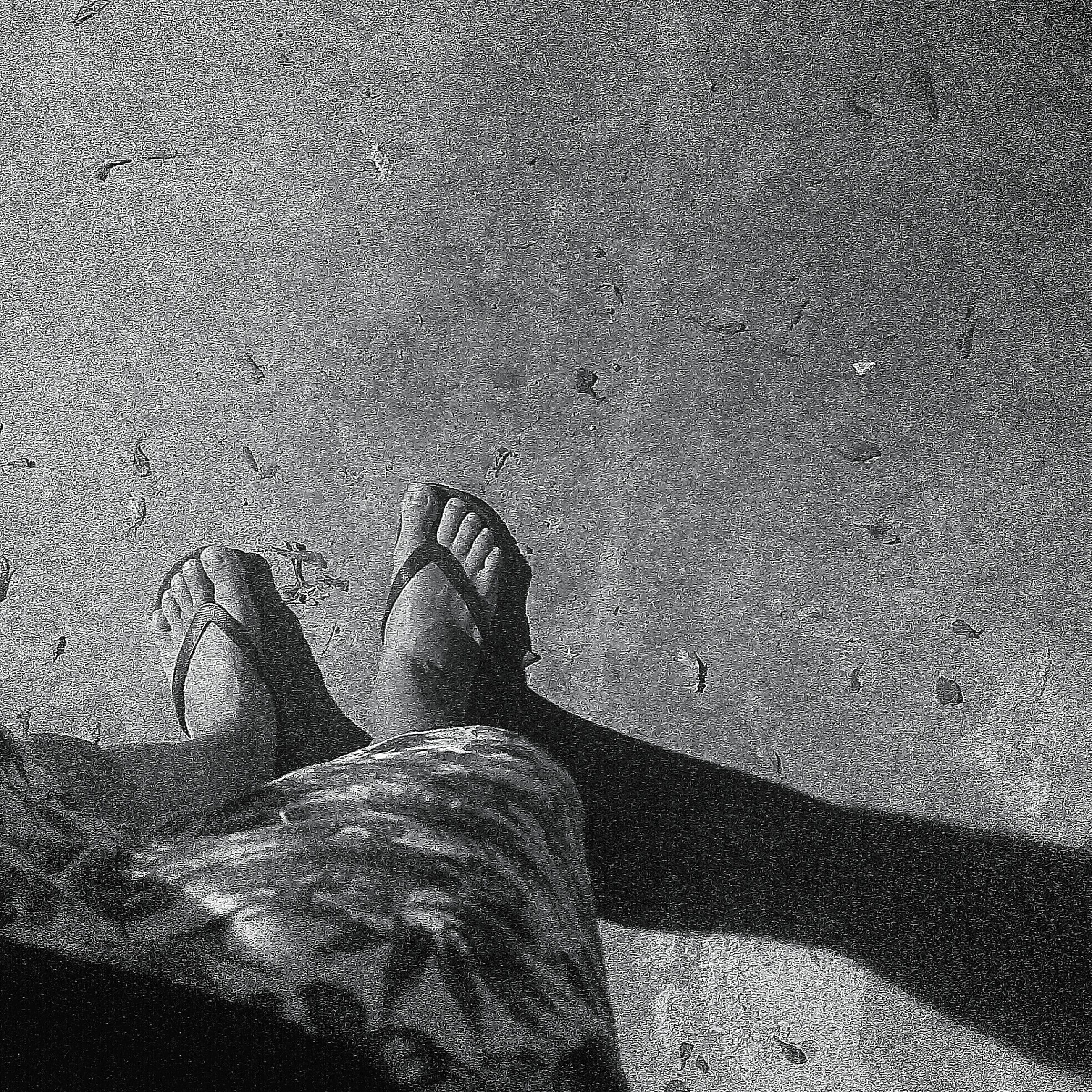 high angle view, shadow, low section, unrecognizable person, lifestyles, sunlight, focus on shadow, person, street, day, leisure activity, personal perspective, outdoors, men, standing, human foot, relaxation