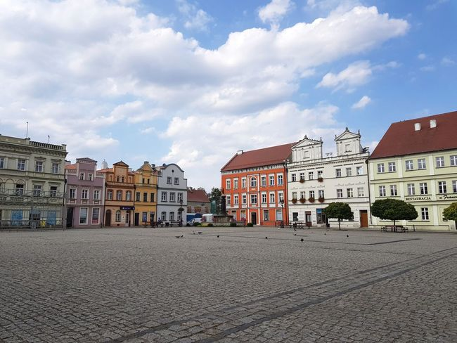 historic tenements in the main square Poland Tourism Travel Destinations Cityscape Sand City Sky Architecture Building Exterior Cloud - Sky Historic Old Town Townhouse TOWNSCAPE Residential Structure History Historic Building