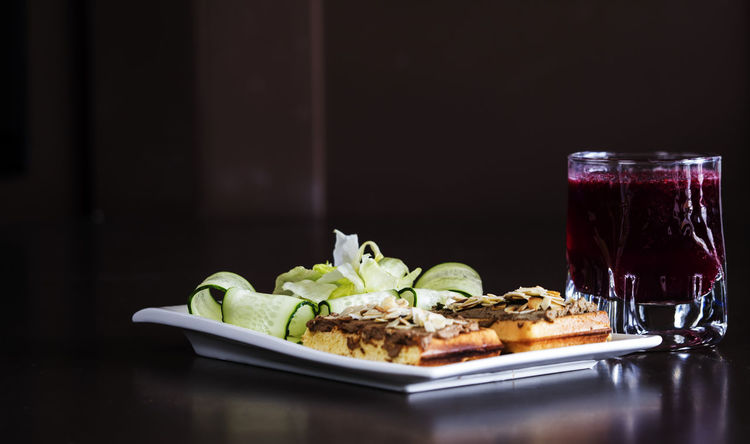 Liver pate on a Belgian waffle Belgian  Black Background Close-up Day Food Food And Drink Freshness Healthy Eating Indoors  Lettuce Liver Meal No People Pate Plate Ready-to-eat Salad Serving Size Table Visual Feast Waffle