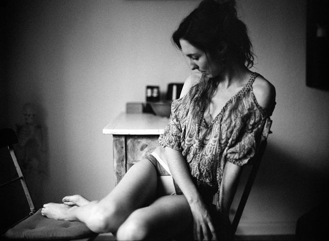 Adult Analog Beautiful Woman Blackandwhite Clothing Contemplation Domestic Room Hairstyle Home Interior Indoors  Leisure Activity Lifestyles Long Hair Looking Mediumformat One Person Real People Sitting Three Quarter Length Women Young Adult Young Women