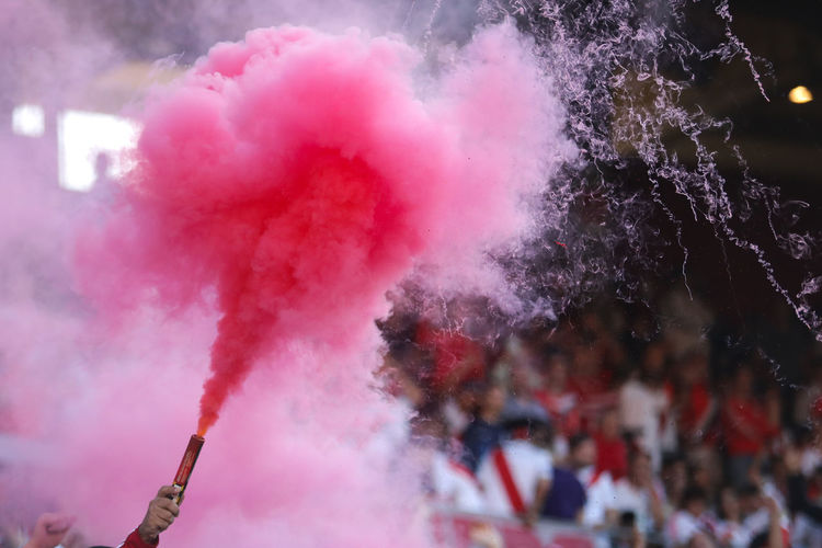 Soccer Candle Smoke Smoke - Physical Structure Day No People Motion Outdoors Focus On Foreground Pink Color Nature Close-up Multi Colored Celebration Selective Focus Red Water Connection Firework