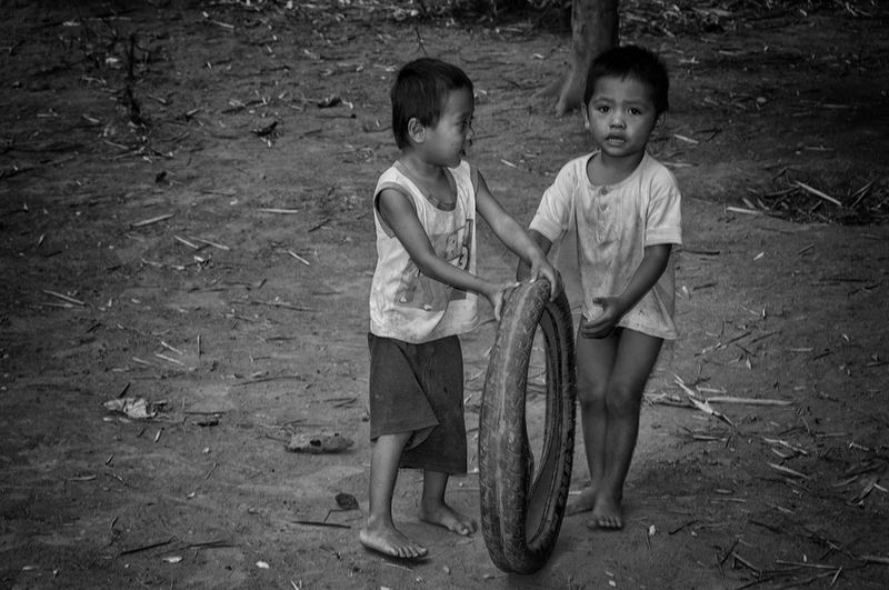 Kids toy made from recycled tire Kids Kids Playing Black And White Boys Child Childhood Children Only Friendship Looking At Camera Outdoors Portrait Recycled Tires EyeEmNewHere EyeemPhilippines EyeEmNewHere